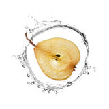 Pera amarela no respingo da água Foto de Stock Royalty Free