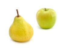 Pera amarilla y manzana verde Imágenes de archivo libres de regalías