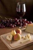 Pera con el vino y el queso Foto de archivo