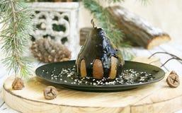 Pera de sobremesa do Natal com chocolate fotografia de stock royalty free