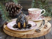 Pera de sobremesa do Natal com chocolate imagem de stock