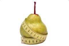 Pera e uma fita de medição Fotografia de Stock Royalty Free