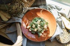 Pera ed insalata della rucola con i pinoli Immagini Stock Libere da Diritti