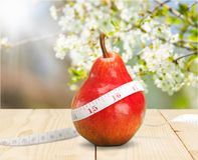 Pera fresca vermelha com a fita na saúde do fundo e Fotos de Stock