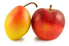 Pera gialla e mela rossa Fotografia Stock