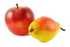 Pera gialla e mela rossa Fotografia Stock Libera da Diritti