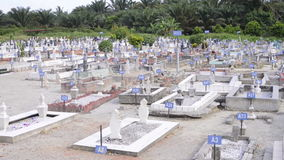 PERAK, MALAYSIA, Circa July 2015 - A wide angle view of a big Muslim graveyard in the town of Ipoh, Perak. stock footage