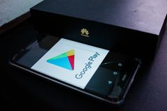 The close up photo of Huawei box with Chinese HUAWEI logo and Google Play logo on the smartphone royalty free stock photo
