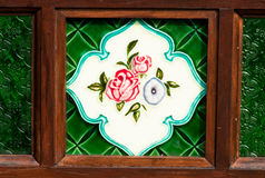 Peranakan Decoration. Decorated ethnic peranakan glass window and tile Royalty Free Stock Photo