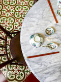 Peranakan. Dining table and floor tile Royalty Free Stock Image