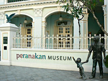 Peranakan Museum. Name of the Peranakan Museum at the entrance next to the statues in Singapore city Royalty Free Stock Photo