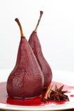 Peras caçadas no vinho vermelho Fotos de Stock Royalty Free