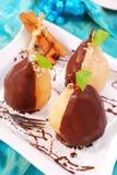 Peras derramadas com chocolate Fotos de Stock Royalty Free