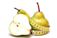 Peras e uma fita de medição Fotografia de Stock