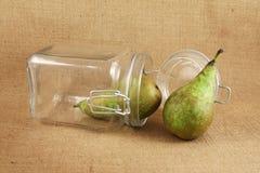 Peras em um frasco de vidro Imagens de Stock Royalty Free