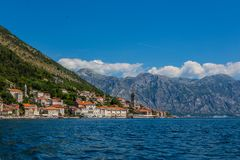 Perast city in Kotor bay. With beautiful mountains and boat floating in Montenegro Stock Image