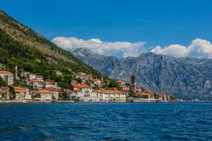 Perast city in Kotor bay. With beautiful mountains and boat floating in Montenegro stock photo