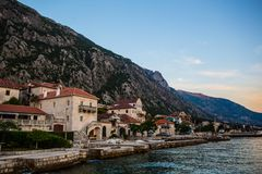 Perast city in Kotor bay at sunset. With beautiful mountains and boat floating in Montenegro Royalty Free Stock Photos