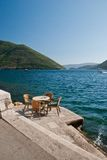 Perast. Coffee table by the sea in Perast in the Bay of Kotor, Montenegro Stock Image