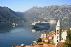 Perast, Montenegro. Aerial view on town Perast with Church Our Lady of the rocks and cruise liner. Montenegro Royalty Free Stock Photo