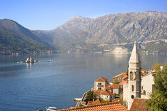 Perast, Montenegro. Aerial view on town Perast with Church Our Lady of the rocks and cruise liner. Montenegro Stock Images