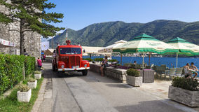 PERAST, MONTENEGRO - AUGUST 27. fire retro car on the waterfront Stock Image