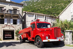PERAST, MONTENEGRO - AUGUST 27. fire retro car on the waterfront Royalty Free Stock Photography
