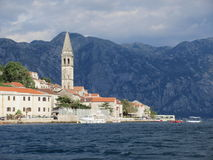Perast Montenegro. The historic town of Perast Montenegro sitting proudly in the bay of Kotor against the omnipresent mountains Stock Image