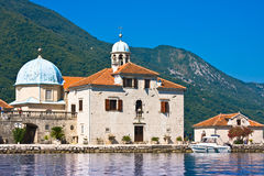 PERAST, MONTENEGRO - JULY 8, 2015: Gospa od Skrpjela,  Montenegro. Small church in a Bay of Kotor Stock Photo