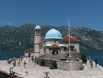 Perast, Montenegro - June 10. 2019: Church Of Our Lady Of Rocks On Artificial Island Of Gospa Od Skrpjela Royalty Free Stock Photos