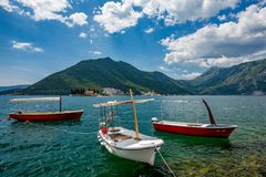 Three boats and two island churches, Montenegro royalty free stock image