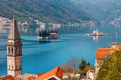Perast. View of islets of St. George and Our Lady of the Rocks through Perast, Montenegro Royalty Free Stock Photos