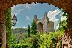 Peratallada, Costa Brava, Cataonia, Spain. Peratallada, Costa Brava, Cataonia, Spain: Famous medieval square at daytime with flowers Royalty Free Stock Photos