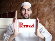 Perazzi shotguns company logo. Logo of Perazzi shotguns company on samsung tablet holded by arab muslim man. Perazzi is a manufacturer of precision shotguns from Stock Image