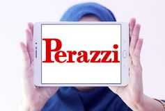 Perazzi shotguns company logo. Logo of Perazzi shotguns company on samsung tablet holded by arab muslim woman. Perazzi is a manufacturer of precision shotguns Stock Photos