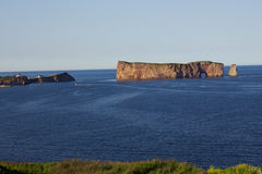 Perce Rock in Gaspesie. Percé Rock  is a huge sheer rock formation in the Gulf of Saint Lawrence on the tip of the Gaspé Peninsula in Quebec, Canada, off Perc Royalty Free Stock Photo