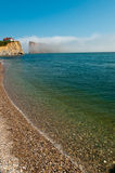Perce rock under clouds_2 Stock Image