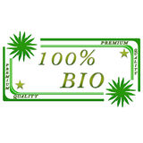 100 percent bio label. 100 percent bio badge /premium quality on white background with leaflets royalty free illustration