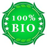 100 percent bio label. On a white background with leaves and stars stock illustration
