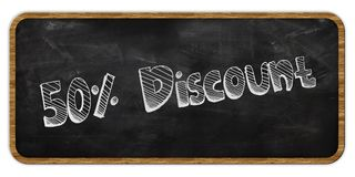 50 PERCENT DISCOUNT written in chalk on blackboard. Wood frame. Illustration Stock Photography