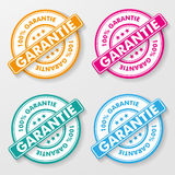100 Percent Guarantee Paper Labels. 100 percent guarantee colorful paper labels. German text 100 % garantie, translate 100% guarantee. Eps 10 file stock illustration