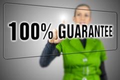 100 percent guarantee. Woman pressing 100 percent guarantee button on virtual screen Royalty Free Stock Photos