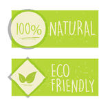 100 percent natural and eco friendly with leaf sign in green ban Royalty Free Stock Photo