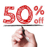 50 percent off. Hand with pen is writing the text 50 percent off on the transparent whiteboard Stock Photos