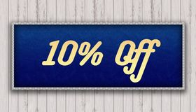 10 PERCENT OFF handwritten on blue leather pattern painting hang. Ing on wooden wall. Illustration Stock Photography