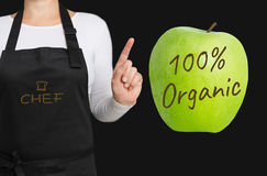 100 percent Organic concept is shown by chef.  Stock Images