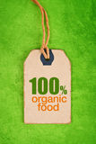 100 Percent Organic Food on Price Label Tag. 100 Percent Organic Food on Vintage Price Label Tag Label on Green Grunge Textured Backgroundas, Top View Royalty Free Stock Photography
