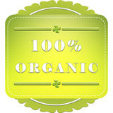 100 percent organic label. 100 percent organic badge on white background with leaves stock illustration