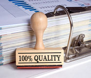 100 Percent Quality - Stamp with binder in the office. 100 Percent Quality - Stamp with binder on desk in the office Stock Images