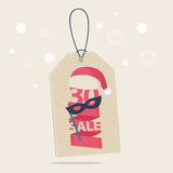 30 percent reduction Christmas sale label. With a red and white Xmas hat and a carnival mask with the word SALE Stock Images